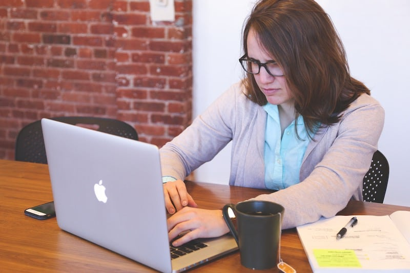 female data scientist working on a laptop